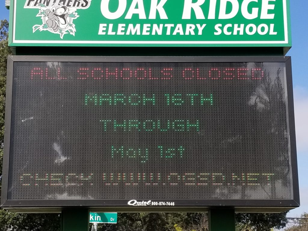 Oak Ridge Elementary School sign announcing the closure of all schools in the Oak Grove School District due to COVID-19 outbreak.